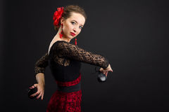 Spanish woman dancing flamenco on black Stock Image