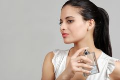 Spanish woman spraying perfume Royalty Free Stock Photography