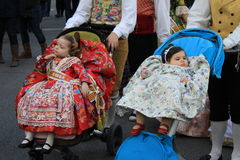 Spanish girls in Valencia , Spain. Valencian girls in traditional costumes in Valencia, Spain during the festival Las Fallas Stock Image