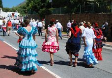 Spanish women walking in procession, Marbella. Royalty Free Stock Photos