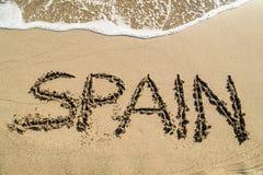 Spanje - conceptentekst op strand Stock Foto's