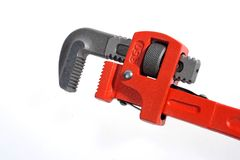 Spanner. A the red installed piping wrench Stock Images