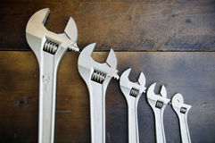Spanner or adjustable wrench on wooden back ground, Basic hand tools Royalty Free Stock Images