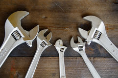 Spanner or adjustable wrench on wooden back ground, Basic hand tools Stock Images