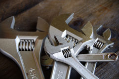 Spanner or adjustable wrench on wooden back ground, Basic hand tools Stock Photography