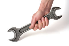 Spanner in a hand Royalty Free Stock Photo