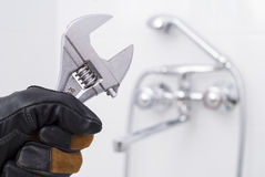 Spanner in hand Stock Photography