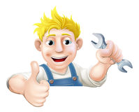 Spanner man over sign thumbs up Stock Photo