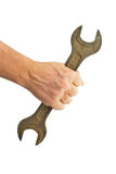 Spanner in a man's hand Royalty Free Stock Images