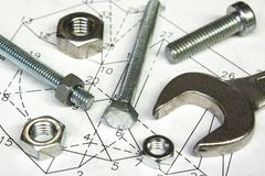 Spanner and nuts royalty free stock photography