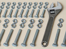 Spanner with nuts and bolts Stock Photo