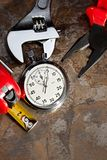 Spanner, pliers and stopwatch Royalty Free Stock Photos