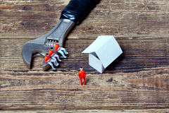 Spanner, toy people and paper Stock Photography