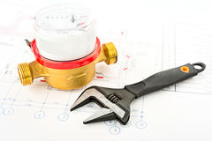 Spanner and water counter Stock Photos