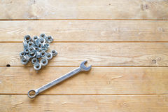 Spanner wrench and nuts Royalty Free Stock Images