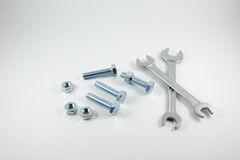 Spanners, bolts and nuts on a white background Royalty Free Stock Photos