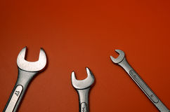 Spanners. Close view of three spanners on orange background Royalty Free Stock Photography