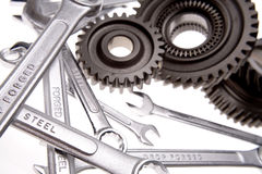 Spanners & cogs. Spanners and cogwheels over white background Royalty Free Stock Photo