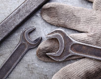 Spanners and gloves on a metal background Stock Image