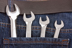 Spanners in jeans pocket Royalty Free Stock Photography