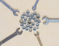 Spanners and nuts on graph paper stock photos