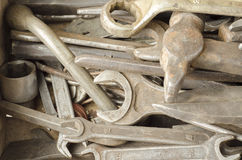 Spanners. Old rusty spanners scattered around the table Stock Photography