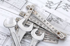 Spanners over house plan. For construction or reconstruction Stock Photos
