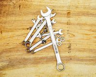 Spanners on a wooden board, top view Stock Image