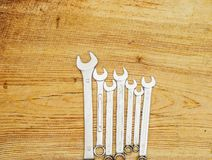 Spanners on a wooden board, top view Royalty Free Stock Image