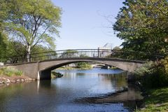 Footbridge on Boston`s Esplanade. Spanning the Storrow Lagoon, this footbridge is located on the esplanade. Ironically the namesake that this is named after Stock Photos
