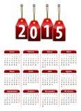 Spansk kalender för 2015 år med röda hängande glansiga etiketter Arkivfoto