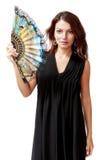 Spansk kvinna med en fan och en svart klänning Arkivfoto