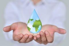 Spara Earth/vattenbegreppet Royaltyfria Bilder