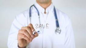 Spara ett liv, doktor Writing på exponeringsglas stock video