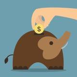 Sparande pengar för elefantbank  Arkivbild