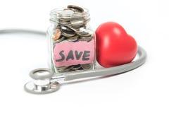 Sparande pengar för medicinskt begrepp Royaltyfria Foton