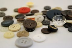 Close up pile of buttons. Spare button clothes fashion design diy project reuse repurpose upcycle upcycling make sew sewing hobby collection stock photos