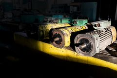 Spare old electric motors in a warehouse of industrial materials stock photos