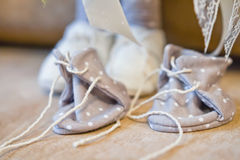 Spare pair of shoes to a textile doll handmade Royalty Free Stock Photo