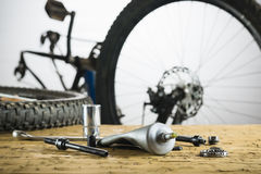 Spare parts on background of the disassembled bike. Stock Image
