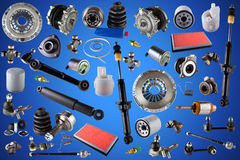 Spare parts car on the blue background. Auto spare parts car on the blue background. Set with many isolated items for shop or aftermarket Stock Images