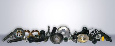 Spare parts car on the grey background set. Many auto parts are located on the edge of the image. OEM parts, auto parts for customer Royalty Free Stock Photo