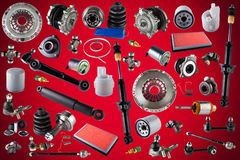 Spare parts car on the red background Stock Images