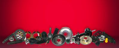 Spare parts car on the red background set. Many auto parts are located on the edge of the image. OEM parts, auto parts for customer stock photo