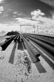 Spare rails beside railway track Stock Photo