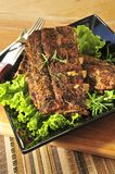 Spare rib dinner. Plate of spare ribs and greens for dinner Royalty Free Stock Photo