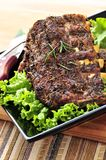 Spare rib dinner. Plate of spare ribs and greens for dinner Stock Images