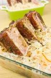 Spare ribs baked in sauerkraut Stock Photos