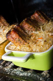 Spare ribs baked in sauerkraut Stock Photography
