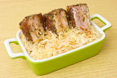 Spare ribs baked in sauerkraut Royalty Free Stock Photos
